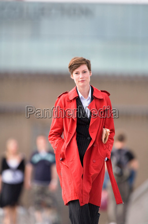 businesswoman wearing trench coat