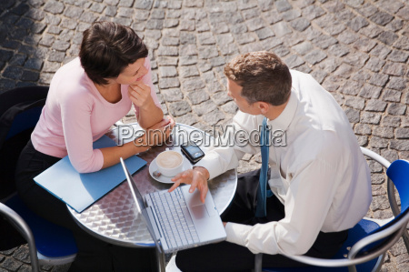 business people working at cafe
