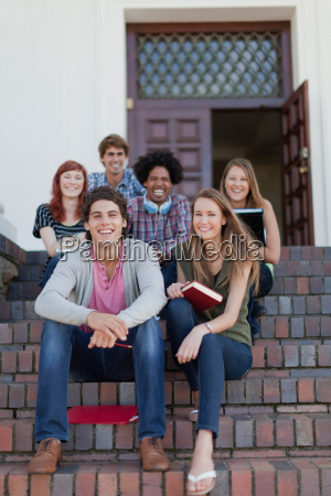 students sitting together on campus