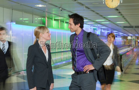 business couple at airport talking