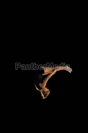 female gymnast upside down mid flight