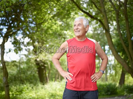 smiling older man standing outside