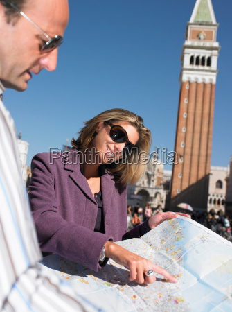 couple looking at a map in