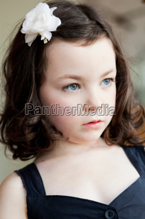 little girl with flower in her