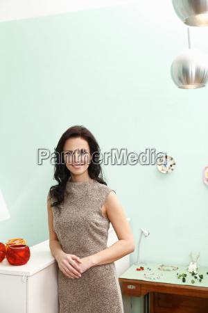 portrait of women standing inside shop