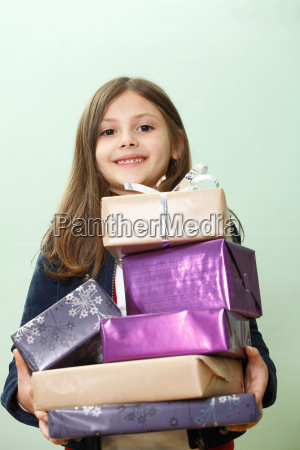 portrait of young girl with presents