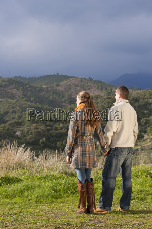 young, couple, holding, hands, in, nature - 18357736