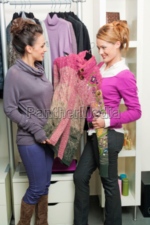 two women in a clothing boutique