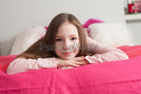 girl lying on back looking at