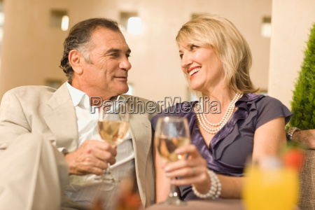 smiling couple having wine together