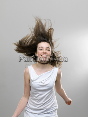 smiling girl jumping for joy