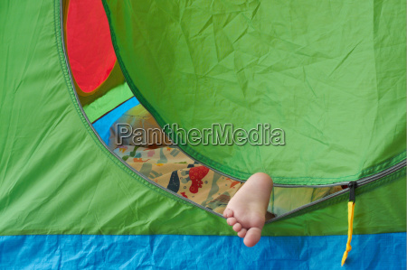toddlers foot sticking out of tent