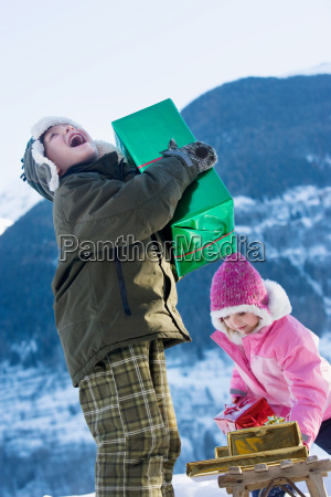 boy and girl with presents in