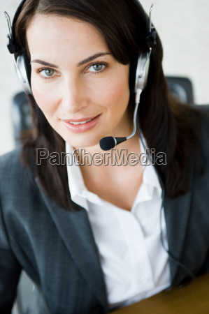 woman with headset looking into camera