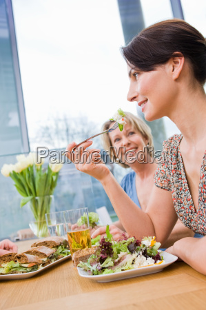 two women eating health food