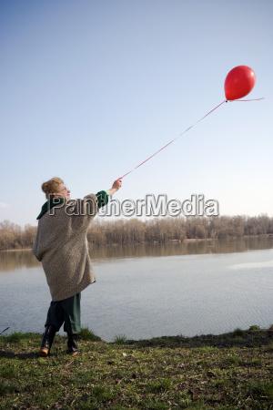 senior woman by river