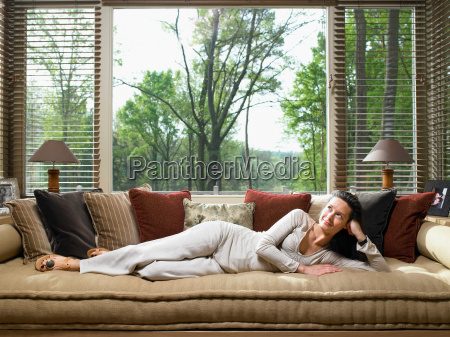 woman sitting on sofa in living
