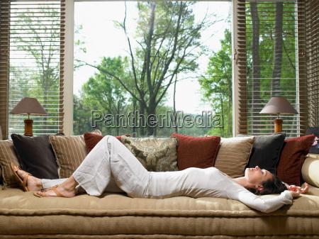 woman sleeping on sofa in living