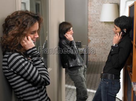 three women talking on mobiles