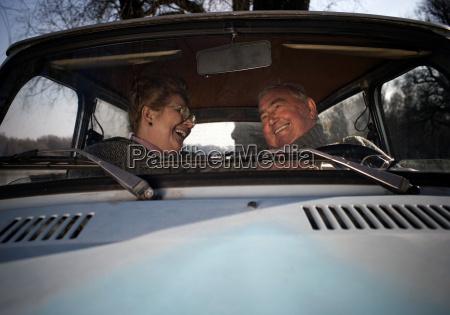 senior couple smiling in car