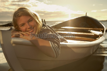 young woman in rowing boat