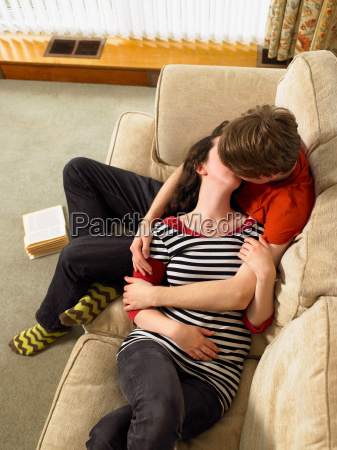 young couple cuddling and kissing