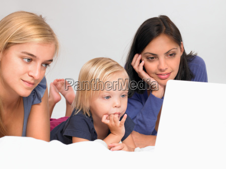 girls looking at a laptop