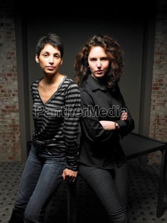 portrait of two women leaning on
