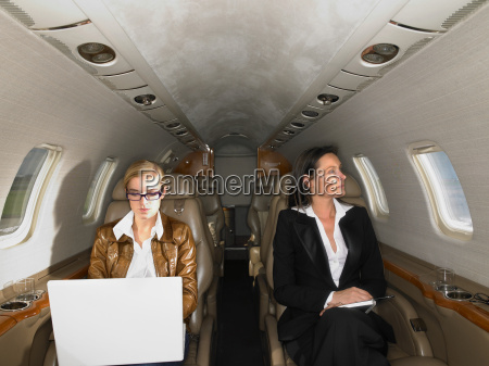 two women in a private jet