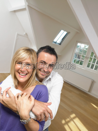 happy couple holding each other