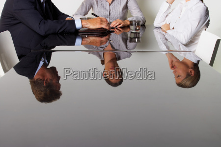 three business peoples reflection