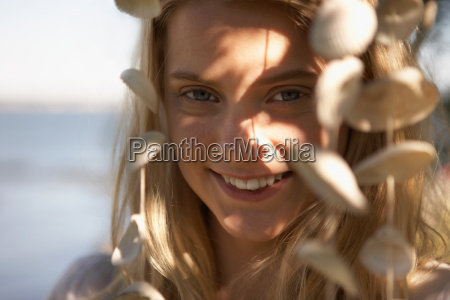 young woman portrait with sea shells