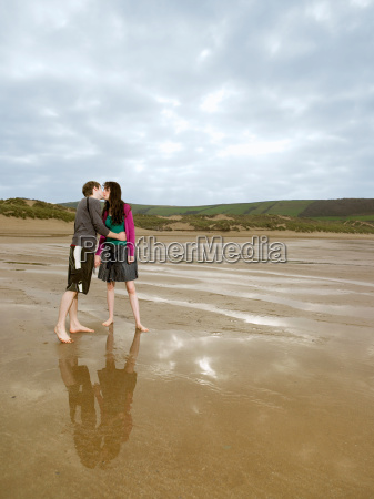 young couple kissing on beach