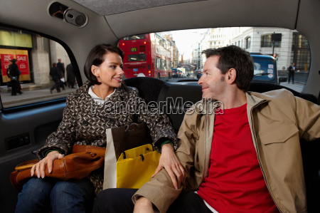 couple in london taxi with bags