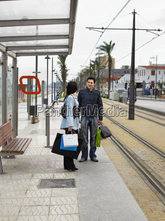 young couple holding shopping standing
