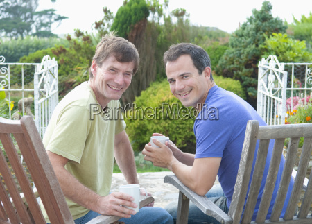 two male adult friends relaxing in