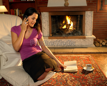 young woman sitting on rug