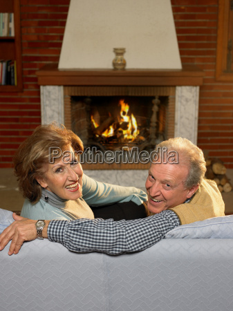 senior couple relaxing in living room