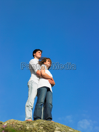 young couple on a large rock