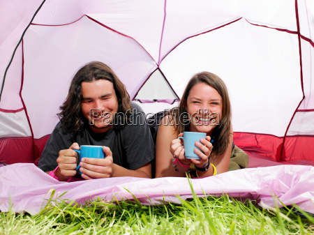 couple with mugs in pink tent