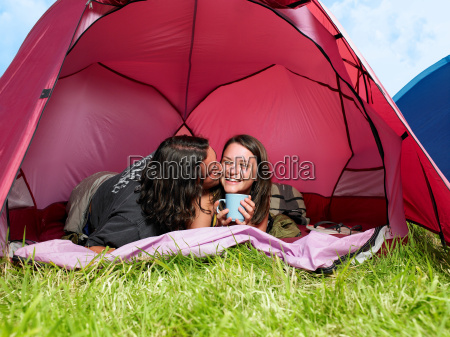 couple kissing in pink tent