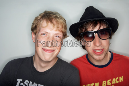 two young males one wearing glasses