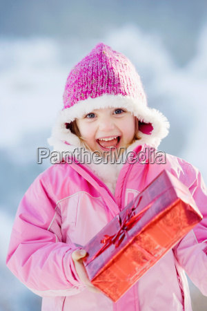 portrait of girl with present in