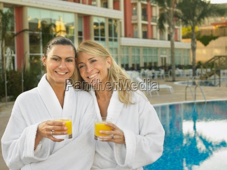 two women by hotel pool with