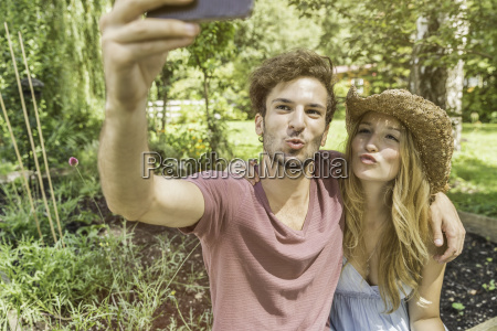 young couple taking selfie with cell