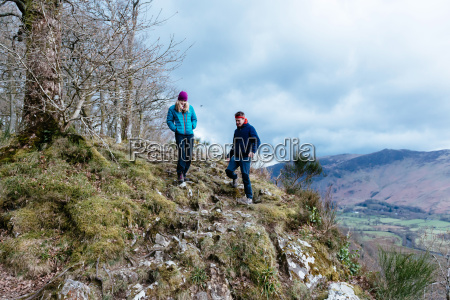 young couple hiking derwent water keswick