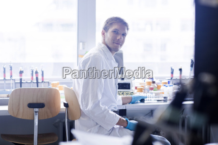 portrait of young male scientist at