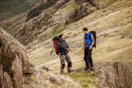 two young male hiking friends laughing