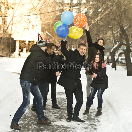 group of young friends with party