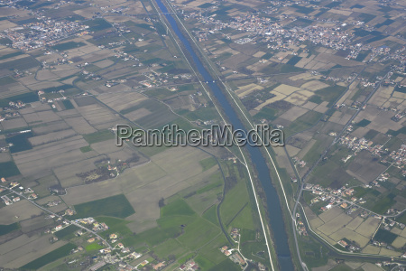aerial view of canal and cultivated